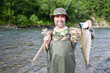 Fisherman holds caught pink salmon.
