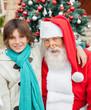Happy Boy With Arm Around Santa Claus