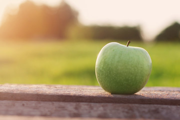 green apple on table outdoors