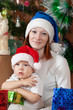 boy and mother in Santa hat