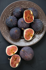 Ripe fig fruits in ceramic plate, view from above