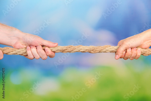 Tug of war, on bright background