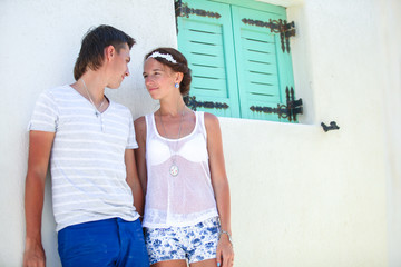 Young couple together enjoy their vacation in old greek village
