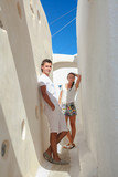 Young couple in love walking in the narrow streets of the