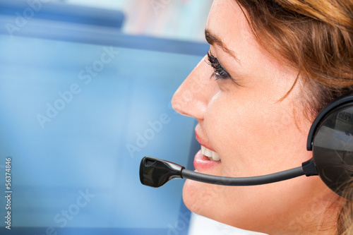 Woman talking on headset.
