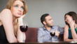 Blonde woman feeling jealous of couple flirting beside her