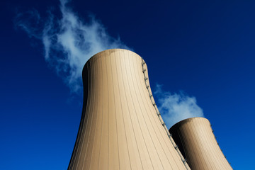 Cooling towers of nuclear power plant against  blue sky