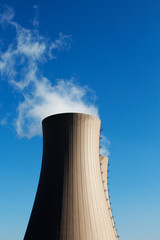 Cooling towers of nuclear power plant against a blue sky
