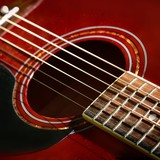 red acoustic guitar close-up