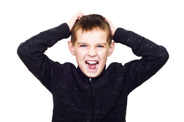 Close-up portrait of boy shouting madly with his hands over his