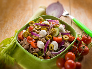 cold pasta salad with mozzarella, selective focus
