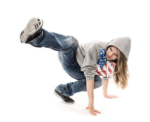 Young girl break dancer moving on the floor, isolated
