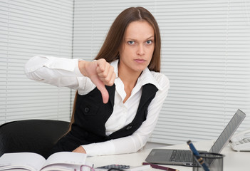 young business woman showing dislike sign