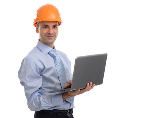 Architect in helmet with laptop