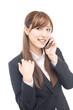 携帯電話を使うビジネスウーマン