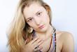 Portrait of the beautiful girl in costume jewellery
