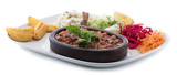 Beef casserole on a terracotta plate with salad and pasta