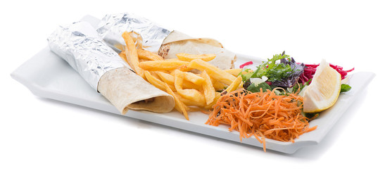 Plate of rolled pancakes with french fries and salad on the side