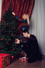 Young couple near a Christmas tree