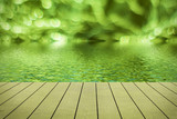 Abstract bokeh reflected in water, view from wooden pier.
