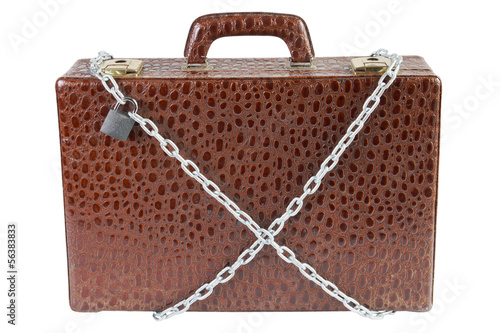 Suitcase is chained with padlock isolated over white