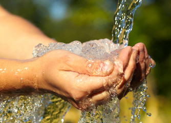 Woman's hands with water splash