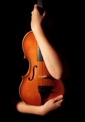 Old violin in woman hands