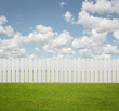 White fence on the grass with copy space
