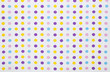Colorful polka dotted textile with copy space
