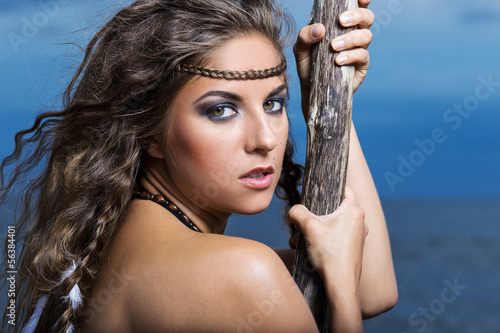Woman is posing with a stick