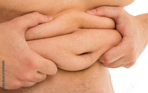 Man holds his fat tummy