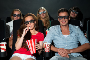 Friends watching 3D movie at cinema