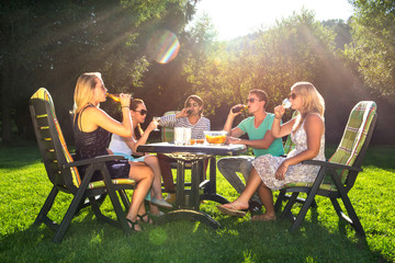 Friends enjoying garden party on a sunny afternoon
