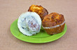 Assorted muffins arranged on a green plate
