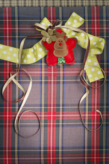 Tartan background texture with polka dots and yellow ribbon
