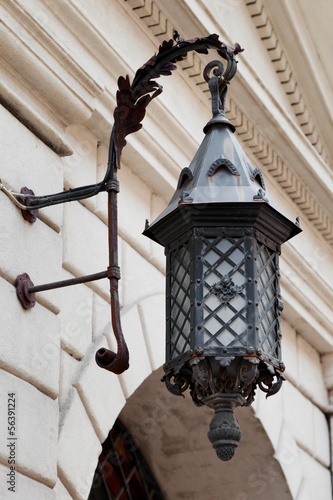 decorative decorative street lamp on building wall