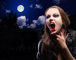 Vampire woman on night background