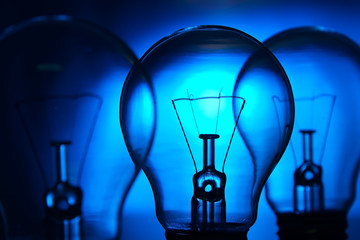 Row of light bulbs n a bright blue background