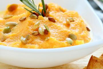 fresh pumpkin soup in a white bowl
