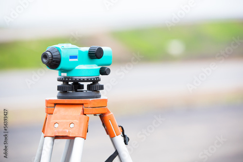 Land surveying equipment theodolite during road works