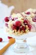 glass of raspberry dessert on a white background teapot