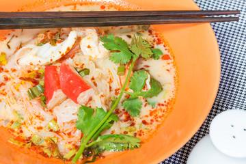 Tom Yum Seafood Noodle in Orange Bowl