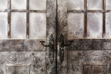 Snowy and icy decorated old styled doors