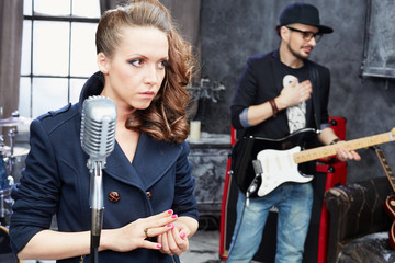 Female lead vocal and guitarist in studio