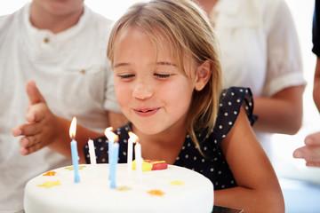Girl Celebrating Birthday With Cake
