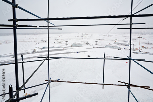 View of snow covered airdrome from scaffold