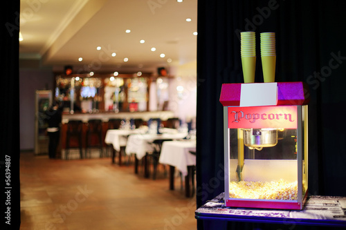 Popcorn machine in background of restaurant and bar