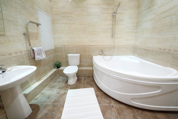 Light and clean bathroom with toilet with tiles on floor