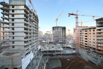 Multi-storey buildings under construction and cranes