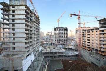 Multi-storey buildings under construction and cranes